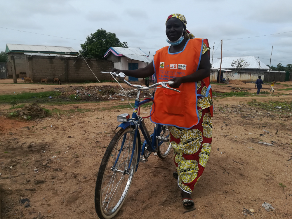 Mama's sensitisation activities are eased by the project bicycle offered by the United Nations Children's Fund, UNICEF.
