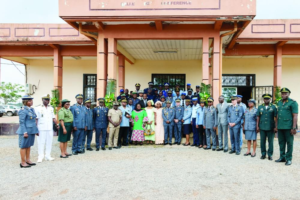 Trained officers ready to serve their countries pose with authorities.