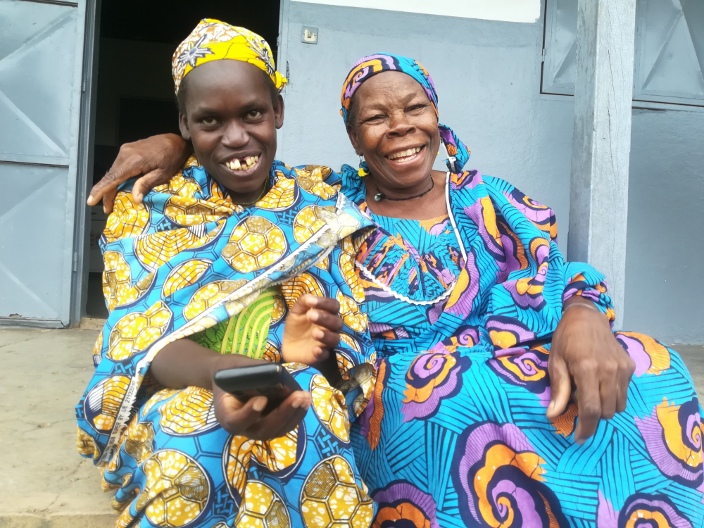 Rabyatou's newfound joy is shared by her aunt-caregiver, Haram Koulsoumi (right).
