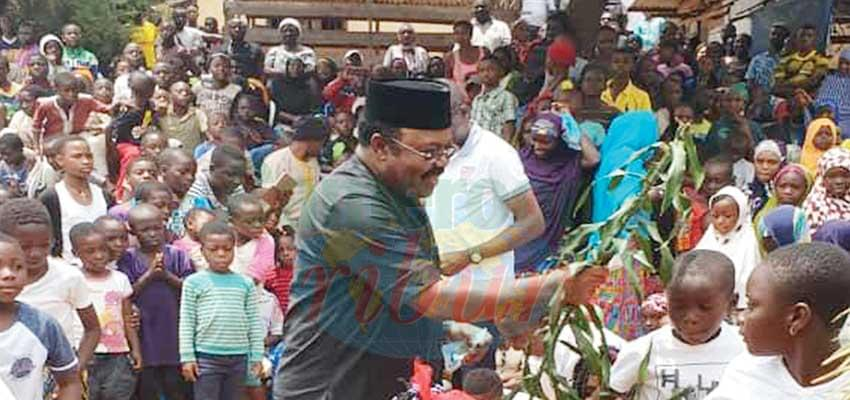 Minister Mbayu with peace plant in hand as he communes with the population