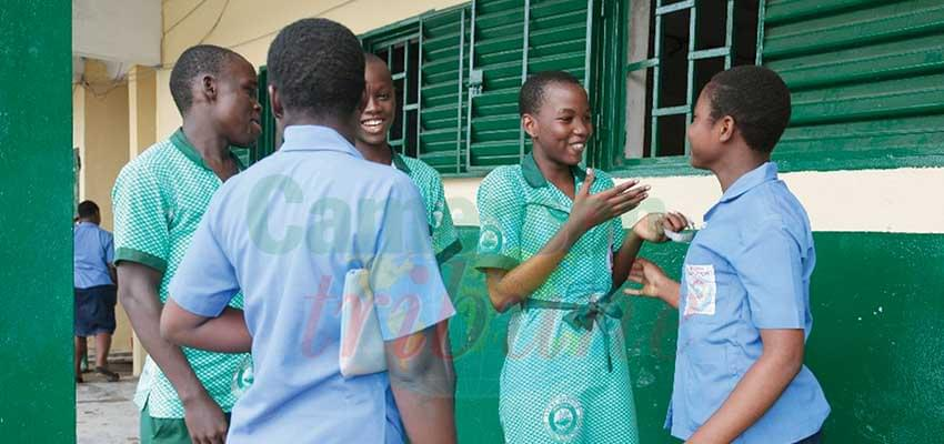 Students of Lycee Bilingue Deido go to school with two uniforms; old and new as parents find it difficult to acquire the new uniform.