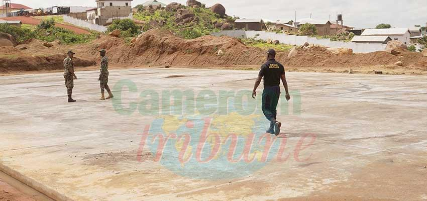 Military engineers inspect multipurpose court.
